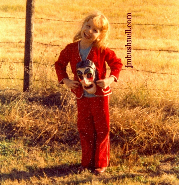 Jeannie M. Bushnell at five years old with Halloween witch mask.