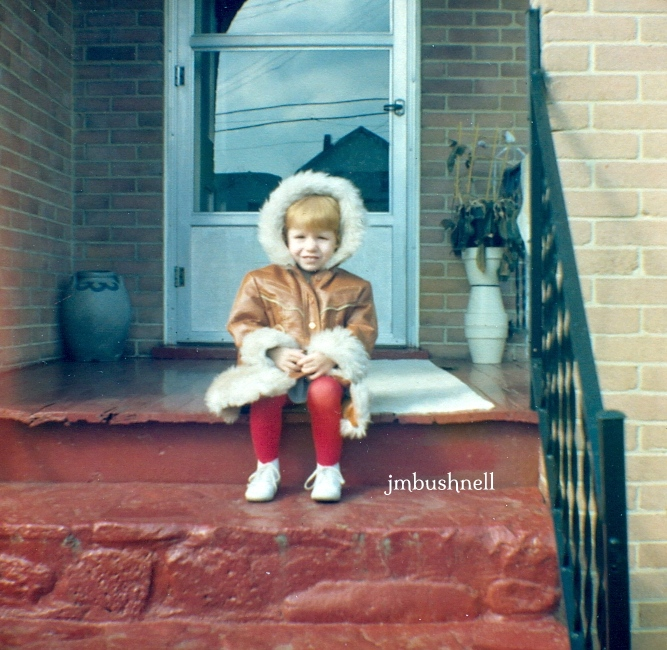 Photograph of Jeannie M. Bushnell as a young child in a coat.