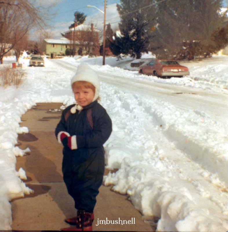 A photograph of Jeannie at age 3 in snow.