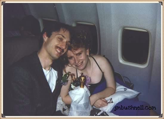 Jeannie and her husband on the airplane after wedding.